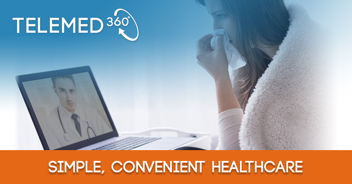 Woman sitting at computer having telemed video call while wrapped in blanket with tissue to nose